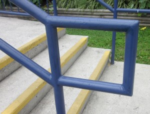 Compliant stair handrail