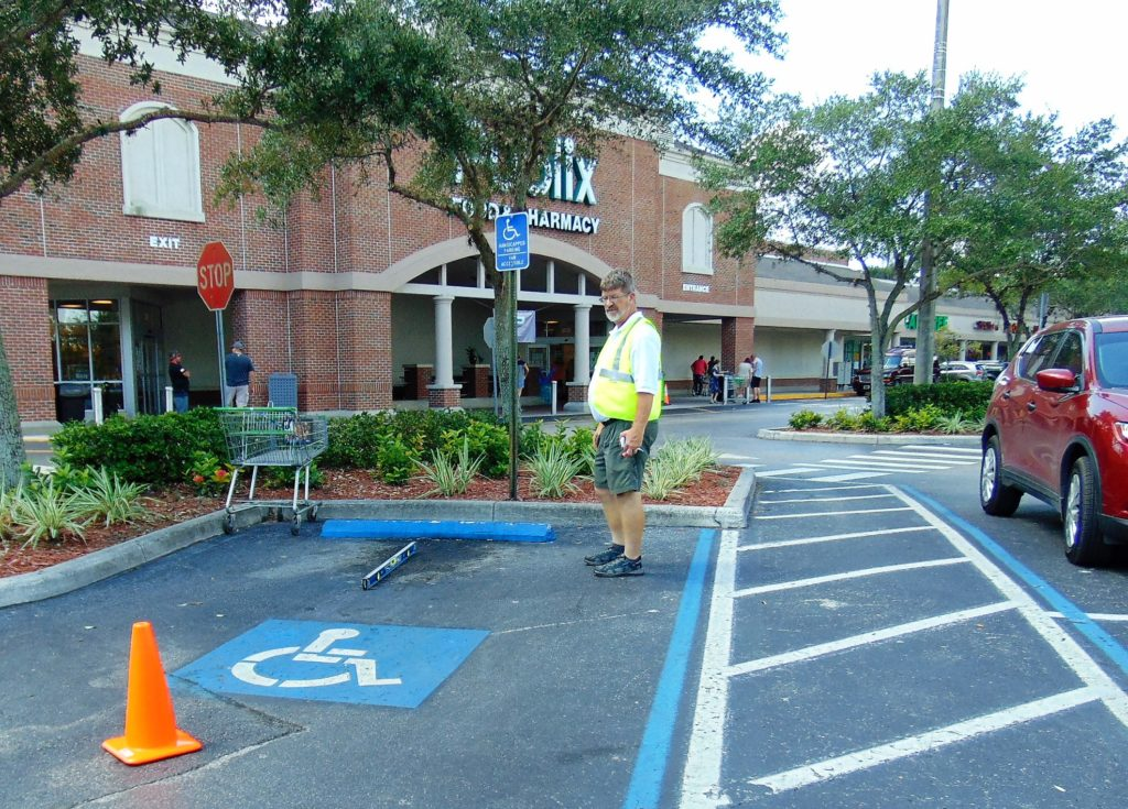 Florida Accessible Parking Space inspection for both running slope and cross slope of the parking space, access aisle and accessible path. Verifying signage. Disability Smart Solutions.