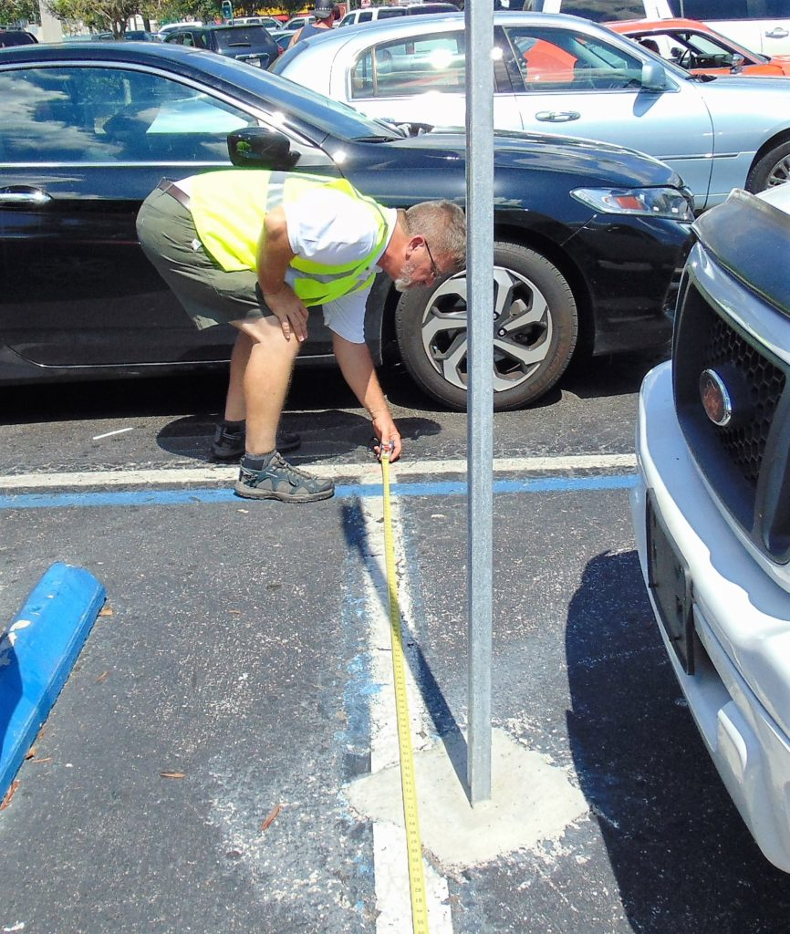 ADA Parking Survey in Florida. Measuring the width of a parking space. Disability Smart Solutions.