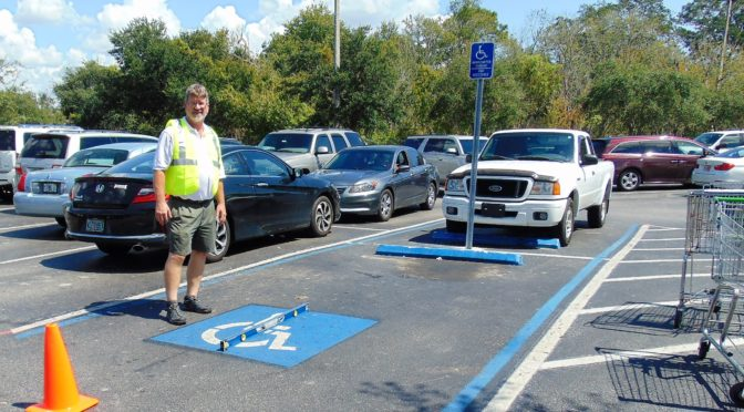 ADA Parking Survey in Florida. Measuring the cross slope of a parking space. Disability Smart Solutions.