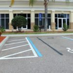 Florida Hotel parking Lot does not have a clear accessible path to the entry. ADA Fail.