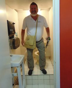 ADA Inspector in a non compliant public restroom. Inspections for ADA Compliance.